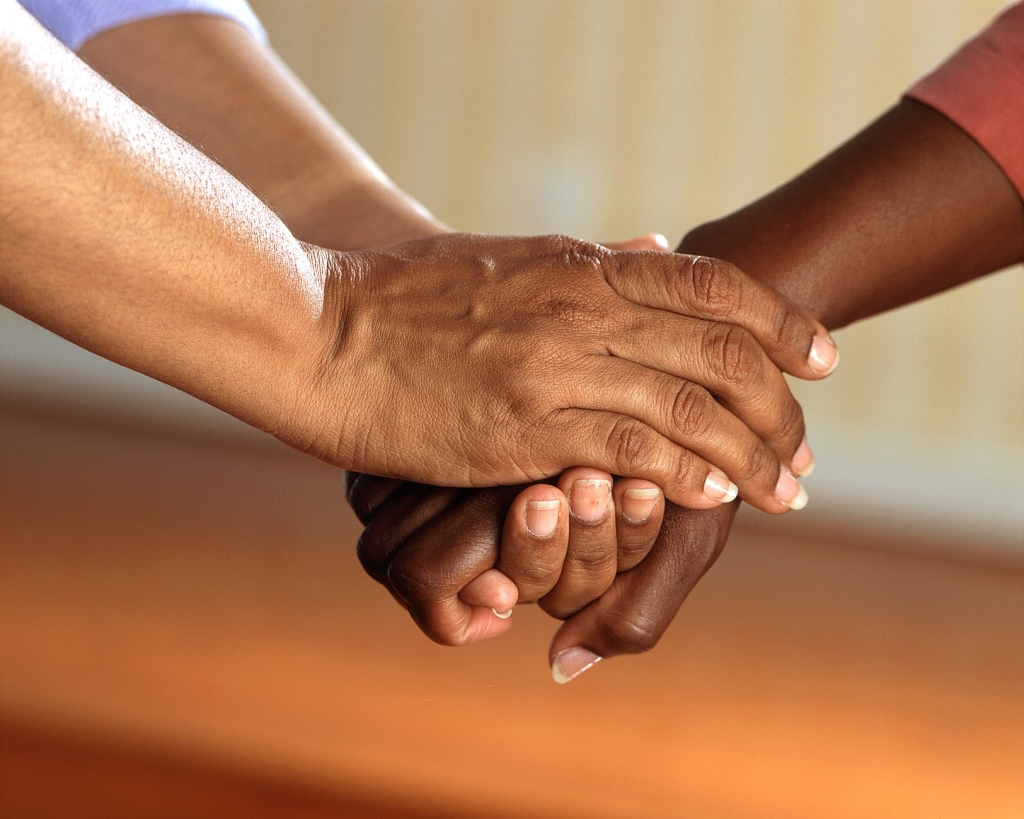 This image has an empty alt attribute; its file name is clasped-hands-comfort-hands-people-45842.jpg